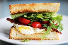breakfast sandwich with tomatos  and baby arugula
