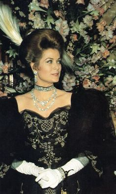 Princess Grace. Monte Carlo, March 25, 1968.  Princess Grace of Monaco dressed as a belle with plumes in her hair. The Princess was attending a 1900s Masquerade Ball, the first to ever be held in a gambling hall casino.
