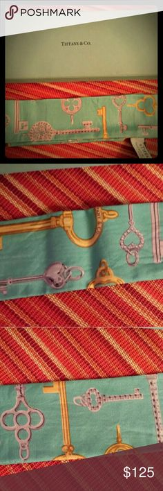 AUTHENTIC Tiffany and Co. key scarf!!! Gorgeous silk scarf in Tiffany blue with the keys motif. Hard to find! Comes with box and red ribbon as it was a Christmas gift. Tiffany & Co. Accessories Scarves & Wraps