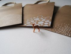 3 unique hand drawn gift bags on brown craft paper by joyfulstudio.