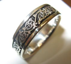 """Claire's Ring (Outlander by Diana Gabaldon) –  """"Reaching, he took the package from my lap and tore away the wrapping, revealing a wide silver band, decorated in the Highland interlace style, a small and delicate Jacobean thistle bloom carved in the the center of each link."""""""
