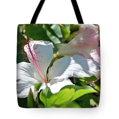 "Hidden Hibiscus Tote Bag by Flamingo Graphix John Ellis (18"" x 18"").  The tote bag is machine washable, available in three different sizes, and includes a black strap for easy carrying on your shoulder.  All totes are available for worldwide shipping and include a money-back guarantee."