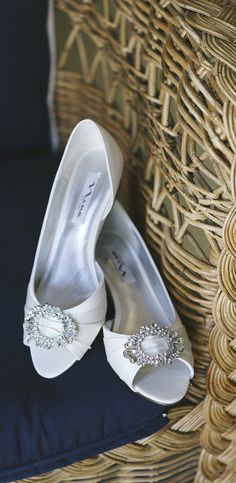 The perfect shoes for a summer wedding! Small wedge and crystal adorned ivory shoes by Nina. Photo by http://aliciakingphotography.com Shoes by http://ninashoes.com/rivka_3341?utm_source=Pinterest&utm_medium=Social%20Media%20Campaign&utm_term=Wedding%20Inspiration&utm_content=Shoes%20on%20Chair%20Wedding%20Shot%20Alicia%20King%20KC%20&utm_campaign=Wedding