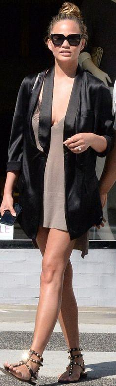 Chrissy Teigen: Purse – Saint Laurent Shoes – Valentino Jacket and sunglasses…