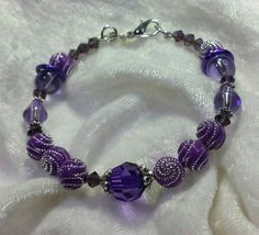 Check out this item in my Etsy shop https://www.etsy.com/listing/216095579/purple-swirly-silver-little-girls-bangle