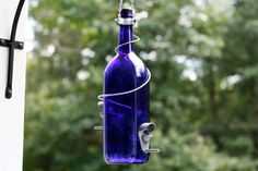 Glass Blue and Silver Wine Bottle Bird Feeder - Bird House - Gift for Mom - Outdoor - Patio - Garden Gift - Gifts Idea - Outdoor Decor - Father's Day Gift - Dad - Gardening - Wedding Decor - Mother's Day Gift - Crafts- Home Decor - Recycle Unique Bird Feeders, Large Wine Bottle, Homemade Bird Feeders, Wine Decor, House Gifts, Garden Gifts, Blue And Silver, Accent Decor, Gifts For Mom