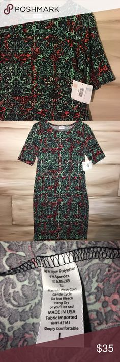 Lularoe Julia Dress Perfect for all occasions and seasons! Black Venetian detail over multicolored background (including mint, coral, powder blue, white and magenta) LuLaRoe Dresses