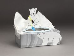 Toss a snowball between the polar bears and the ice floes! Create your own game with recycled tissue box, tissues, and a bit of Crayola® Model Magic®.