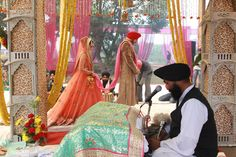 just to give you and idea of the look/setup of a sikh wedding. bride and groom have to walk around holy book 4 times, so we will need plenty of space for that, given my dress is large on the bottom.
