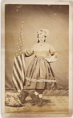"Prototypical young girl, possibly the adopted ""daughter of a regiment,"" posed in vivandiere-like military outfit holding American flag. A genre photographic from American Civil War, American History, American Flag, Old Pictures, Old Photos, Daughter Of The Regiment, Civil War Dress, War Image, Civil War Photos"