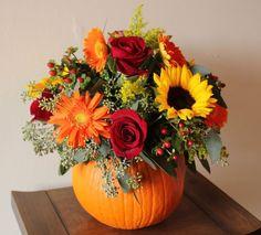 Flowers used:  -sunflower   -gerbra daisy  -rose  -salidago  -hypericum berries - silver dollar