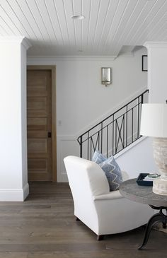 Love the pillow against the white chair. Also love the lamp.  O & D Interiors