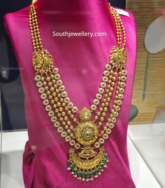 22 Carat gold antique layered haram with nakshi pendant and peacock side mugappu by PMJ Jewels. Antique Jewellery Designs, Gold Earrings Designs, Gold Jewellery Design, Gold Haram Designs, Necklace Designs, Antique Jewelry, Real Gold Jewelry, Diamond Jewelry, Antique Gold