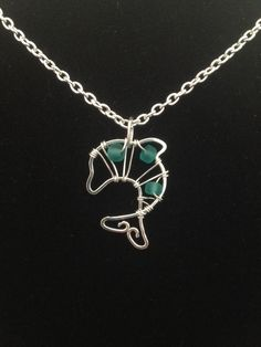Flattened wire and bead dolphin pendant.