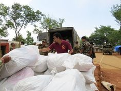 #CARE staff unload family kits in Gorkha, #Nepal, which is one of the most damaged areas by the earthquake. The family kits arrived by road from India. Photo: CARE