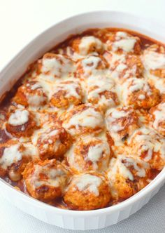 Chicken meatballs with crushed tortilla breadcrumbs baked in enchilada sauce and topped with cheese.