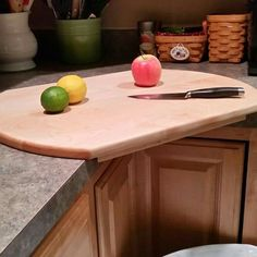 "This is a hand crafted, solid Rock Maple corner cutting board (edge grain).  This cutting board is the perfect piece to fit any corner in your kitchen!   A superb way to maximize your kitchen space and very convenient so you can place your trash receptacle underneath for easy clean up!  Asking $120 and will consider reasonable offers  Dimensions: 24"" wide x 18"" deep x 1.5"" high (top board is 7/8' thick).  It is coated with Mineral and beeswax."