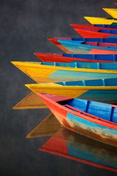 what is it about colorful boats that makes them so damn appealing?! Love.  Rowing in primary color.