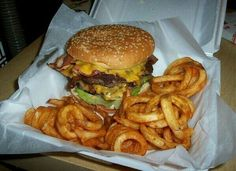 Double bacon cheeseburguer with curly fries.