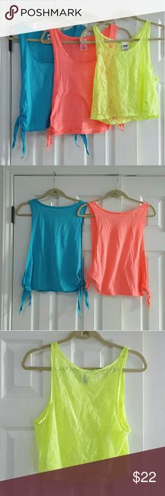 PINK by Victoria's Secret Crop Top Bundle Blue and coral tops same size and style. 60% cotton 40% polyester. Yellowtop is extra small and 100% polyamide. It is very sheer and lacy and see through .  *Condition: Good, used, functional could be one/few minor flaws. No noticeable rips or stains. We try to note every flaw but sometimes we miss the smallest ones please be aware of this before purchasing a used item. PINK Victoria's Secret Tops Tank Tops
