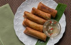 These fried spring rolls may be super simple to make but each bite packs a flavorful punch especially when you dunk it in spicy vinegar dip. Fried Spring Rolls, Lumpia, Super Simple, Vinegar, Punch, Dip, Sausage, Fries, Spicy