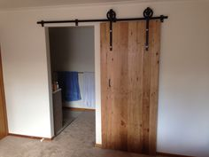 Finished Barn Door. Blackbutt reclaimed timber and custom made rail and rollers.