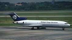 Hinduja Cargo Airlines operated a series of flights into Changi Airport on behalf of Pacific East Asia Cargo in Feb/Mar 1999. Boeing 727-200F VT-LCC is seen taxiing to the airfreight centre after landing at midday.