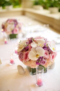 Elegant orchids, frilly peonies and pastel roses make the perfect pairing in these @Mandy Bryant Bryant Dewey Seasons Resort Maui centrepieces.