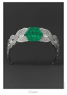 An Art Deco tiara from Cartier, last seen at Cartier's exhibition in Paris 2013-2014. This tiara comprises a large carved hexagonal emerald supported by two twisting strands of diamonds, and was possibly worn bandeau-style across the forehead of the wearer.