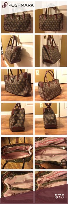Absolutely Geogous D & B Tote Handbag ***Authentic Dooney Burke***Brown Leather trim Handbag with front silver buckle and zipper closure. Has an interior compartment and wall pockets. For Appx size, please see photos attached here. Pre- Owned with no known imperfections noted at time of inspection. Bag is in mint condition. No odor, no hold and No trades. Dooney & Bourke Bags Satchels