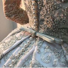 Ana Rosa. Too much beading however I do like the pearls as buttons