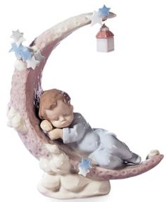 A sleepy little angel snoozes under the stars, in the crook of a crescent moon…