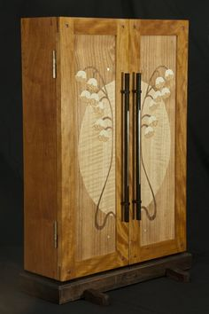 OMG, I love everything by Heller and Heller Custom Furniture, but I'm a sucker for wooden inlays & marquetry. Check out this Lily of the Valley Jewelry Cabinet!