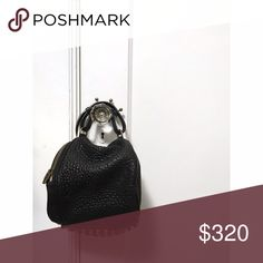 "🔥Price drop - Alexander Wang mini bag Gently used ""Angela Pouchette"" with pebbled leather and brass hardware. In fantastic condition. The only scuffs are shown in 4th photo on the piping. Comes with dust bag • Dimensions: 7.5""H x 8""L x 8""D • Strap drop: 6"" Alexander Wang Bags Mini Bags"