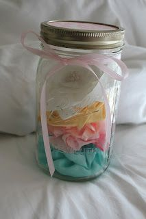 mason jar filled with flower head bands
