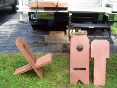 """""""I have a homemade camper chair made out of 2x12 wood.  We sit on it, level the truck with it, throw it under the truck if you're stuck, or cut and split it if we get short on wood.  I strap it to the rear bumper.  It's very easy to make!"""""""