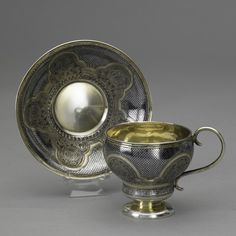 RUSSIAN SILVER GILT NIELLO CUP AND SAUCER, 1867