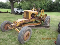 Yellow Allis Chalmers WD motor grader