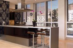 Kitchens are the heart of a home, our Shutters are not only practical and easy to maintain, they are stylish and will suit any kitchen decor theme. Kitchen Shutters, Wood Shutters, American Shutters, Kitchen Decor Themes, Home Decor, Mini Blinds, Kitchen Dining, Dining Room, Kitchen Interior