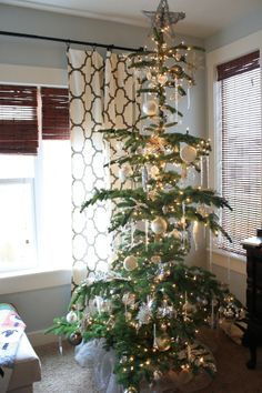 ~ this tree reminds me of the ones I had growing up. (ours weren't QUITE so sparse, but I love this) ~ 6th Street Design School: Feature Friday: Holiday Homes Part 1