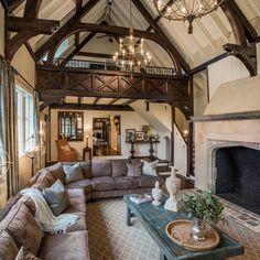 Specifically the arch on the fireplace Classic tudor arch. Tudor style family room with large stone fireplace and loft Tudor House, Tudor Cottage, Style At Home, Casas Tudor, Casa Estilo Tudor, Stone Interior, Interior Design, Tudor Decor, English Tudor Homes