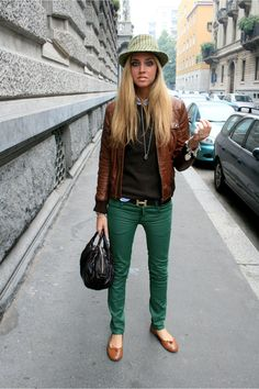 Leather jacket, black sweater, hat, Hermes Belt, green skinny jeans, bag