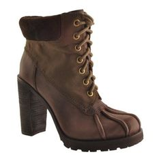 Laverne is a beautiful lace-up boot with a stacked high heel and duck boot toe styling.