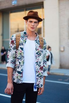 Printed Shirt styled with Plain White T-shirt, pair of Black Jeans and one can…