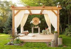 Pergola with curtains.  Like the step up to the pergola.