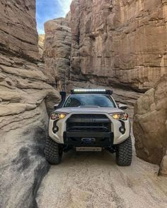 """9 Beast Toyota SUV You Would Love Off Roading! Expect new levels of innovation and legendary reliability from Toyota SUV models. See which luxury Toyota SUV has redefined \""""roughing it\"""". Toyota Tacoma 4x4, Toyota 4runner Trd, Toyota Trd Pro, Tacoma Truck, Toyota Trucks, Jeep Truck, Toyota Suvs, Toyota Corolla, Ford Trucks"""