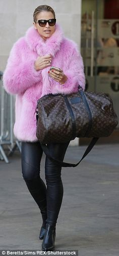 Chic:The model, DJ and TV presenter, 32, turned heads in a striking furry pink coat as she strode down the pavement in west London