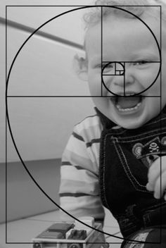 Photo of a child with the Golden Ratio on top of them. The Golden Ratio zeros in on their face which is where the viewer's eye will most likely go first, demonstrating how the Golden Ratio works as a tool and theory. Source: https://realgraphics.wordpress.com/home/oac-the-art-of-photography/the-frame/project-13-the-golden-section/