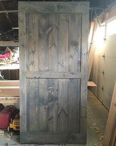 A Mid-Bar with border barn door in Minwax Classic Grey looks just the right amount of rustic and modern #RusticRoo #barndoors #handmade #woodworking #rustic #interior