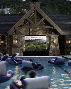 pool, floating chairs, & big screen tv